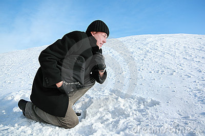 Youth leaning on one knee on snow