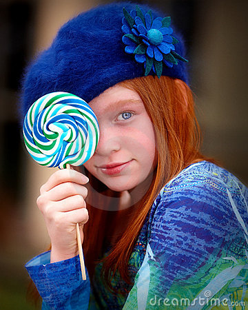 Youth with lolliepop in blue
