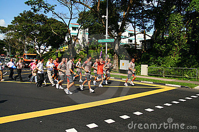 Youth Olympic Games 2010 Torch Relay Editorial Photo