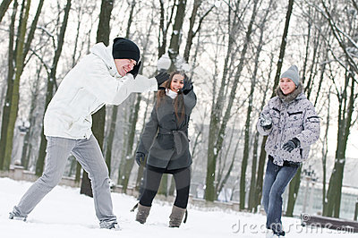 Youth playing winter game snowball