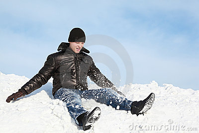 Youth sits on snow and throws him up