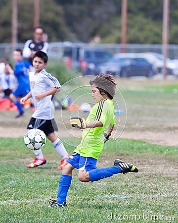 Youth Soccer Football Goalie Kicking the Ball