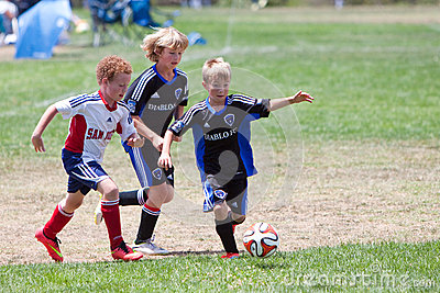 Youth Soccer Football Players Running with the Ball Editorial Stock Image