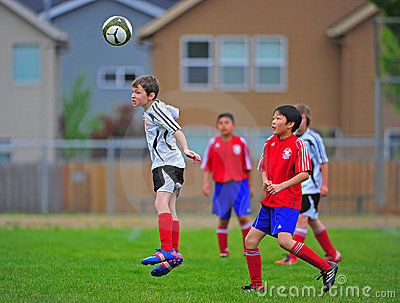 Youth soccer jump for a Head ball Editorial Photo