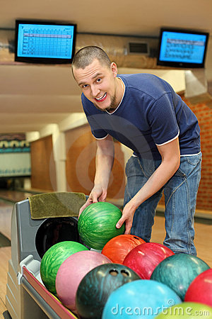 Youth takes ball for playing bowling