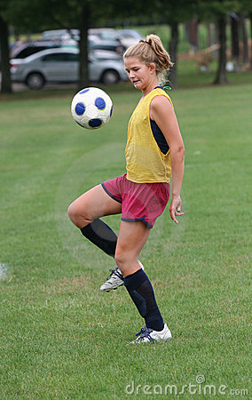 Youth Teen Boucing Soccer Ball in Air