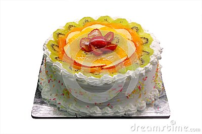 Yummy delicious party cake with sliced fruit piece