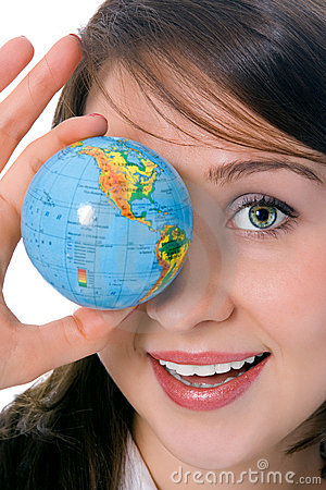 Yung beauty girl hold globe in front of eye