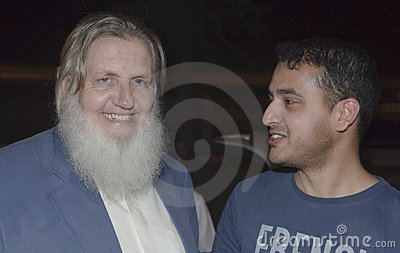 Yusuf Estes, with a student Editorial Stock Image