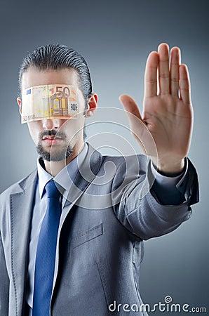 Zakenman die met geld wordt verblind