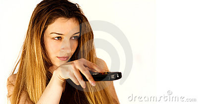 Zapping concept - young woman and remote control