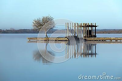 Zen lake in the fog