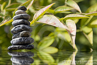 Zen pyramid of stone on the water