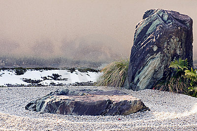 Zen rock and raked gravel landscape feature.