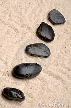 Zen spa river rocks on sand
