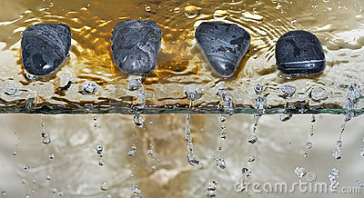 Zen stone pebble water drops
