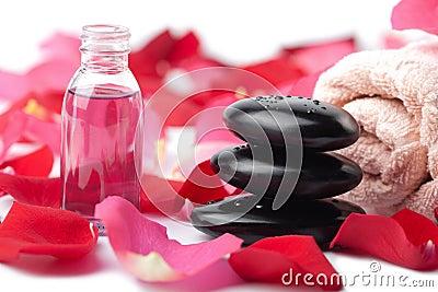 Zen stones, essential oil and rose petals isolated