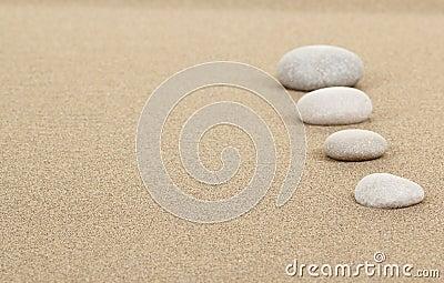 Zen stones in sand