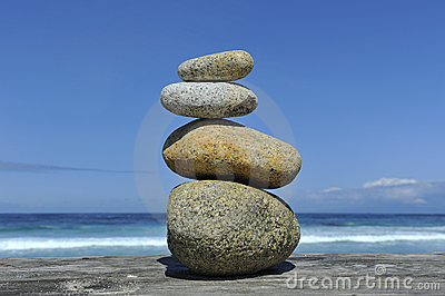 Zen stones stacked at beach copy space
