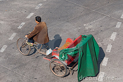 Zhongshan:tricycles on urban street Editorial Stock Image