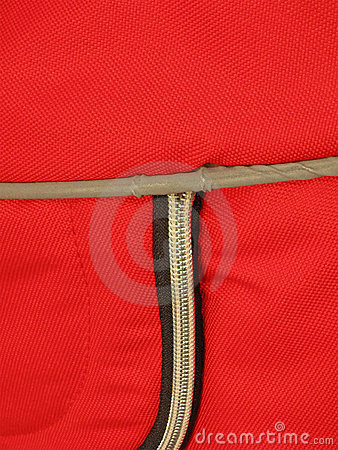 Zip on red textile background,