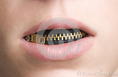 Zipper in Mouth of Youthful Person