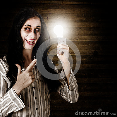 Zombie girl holding lightbulb with bad idea