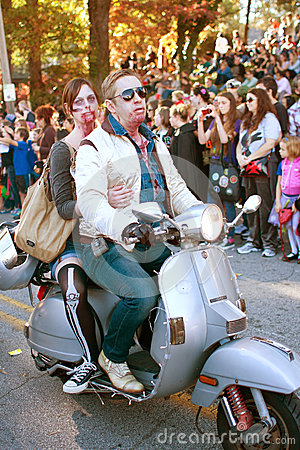 Free Zombie Couple Rides Scooter In Halloween Parade Royalty Free Stock Photos - 28289378
