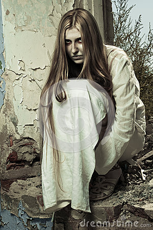 Zombie girl in abandoned building