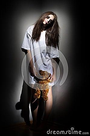 Zombie girl with teddy bear