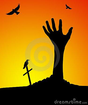 Zombie hand rising out of grave