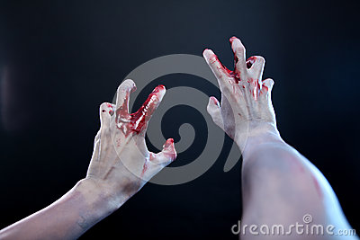 Zombie stretching bloody hands