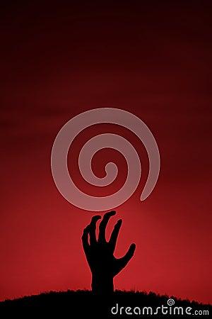 Zombiehand die omhoog komen