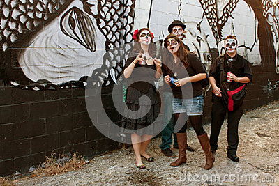 Zombies Smoke Cigarettes and Drink Sodas in Back Alley Editorial Stock Photo