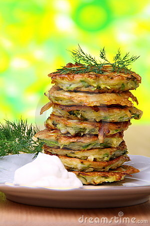 Free Zucchini Fritters With Sour Cream. Royalty Free Stock Images - 21144759