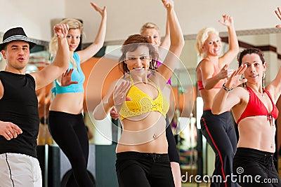 Zumba or Jazzdance - people dancing in studio