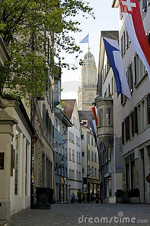 Zurich flagged old town and Grossmunster Editorial Image