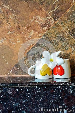 zwei kaffeetassen mit einer blume stockfoto bild 65803984. Black Bedroom Furniture Sets. Home Design Ideas