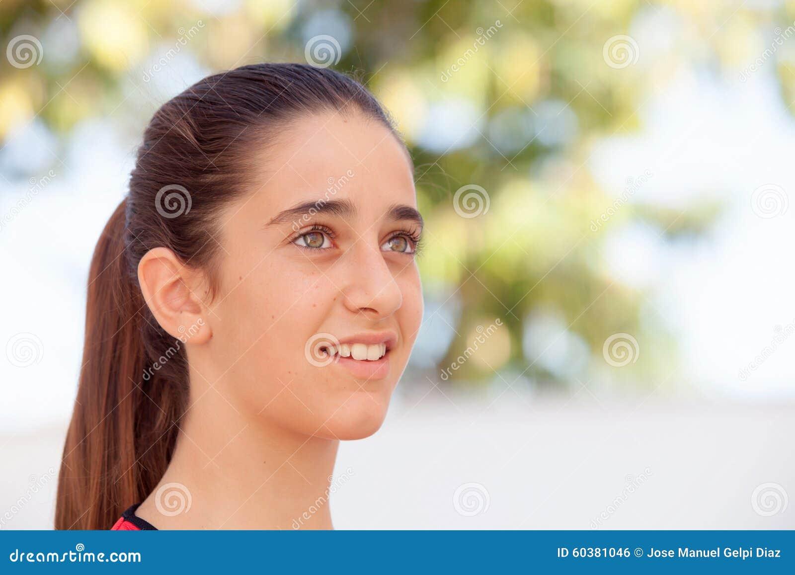 好女孩12岁微笑 库存照片