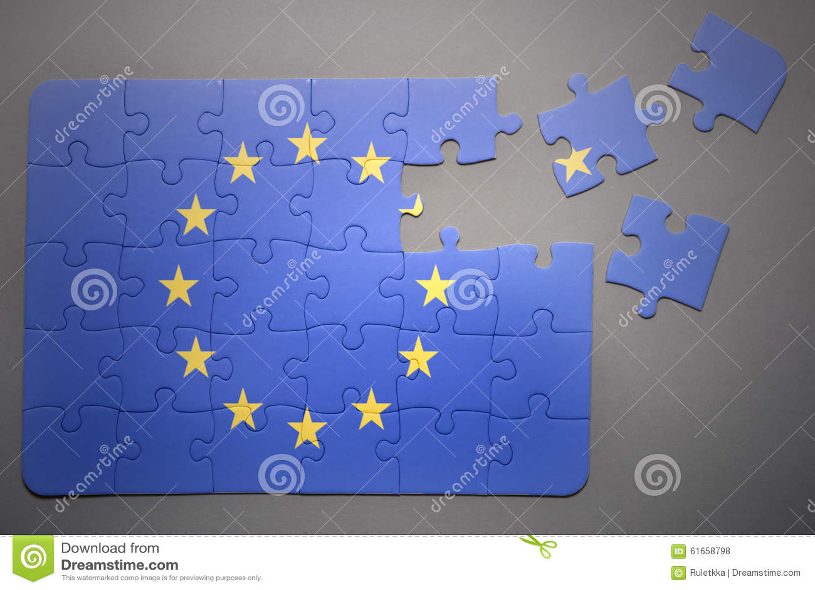 与欧盟国旗的残破的难题在灰色背景的.图片