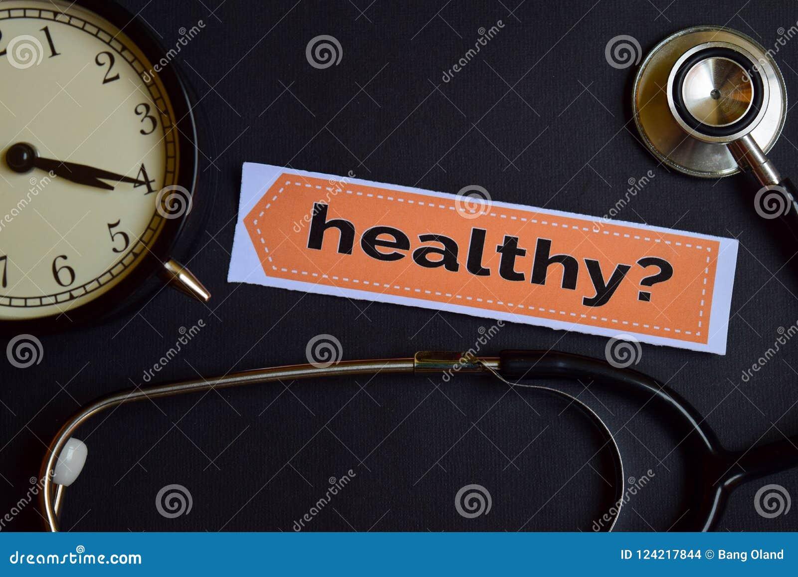 ¿Sano? en el papel de la impresión con la inspiración del concepto de la atención sanitaria despertador, estetoscopio negro