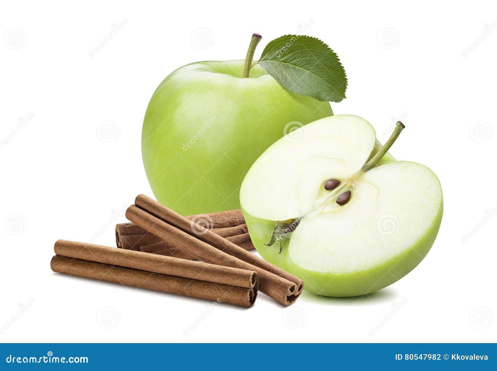 Äpple och halva för helhet grönt plus den isolerade kanelbruna pinnen