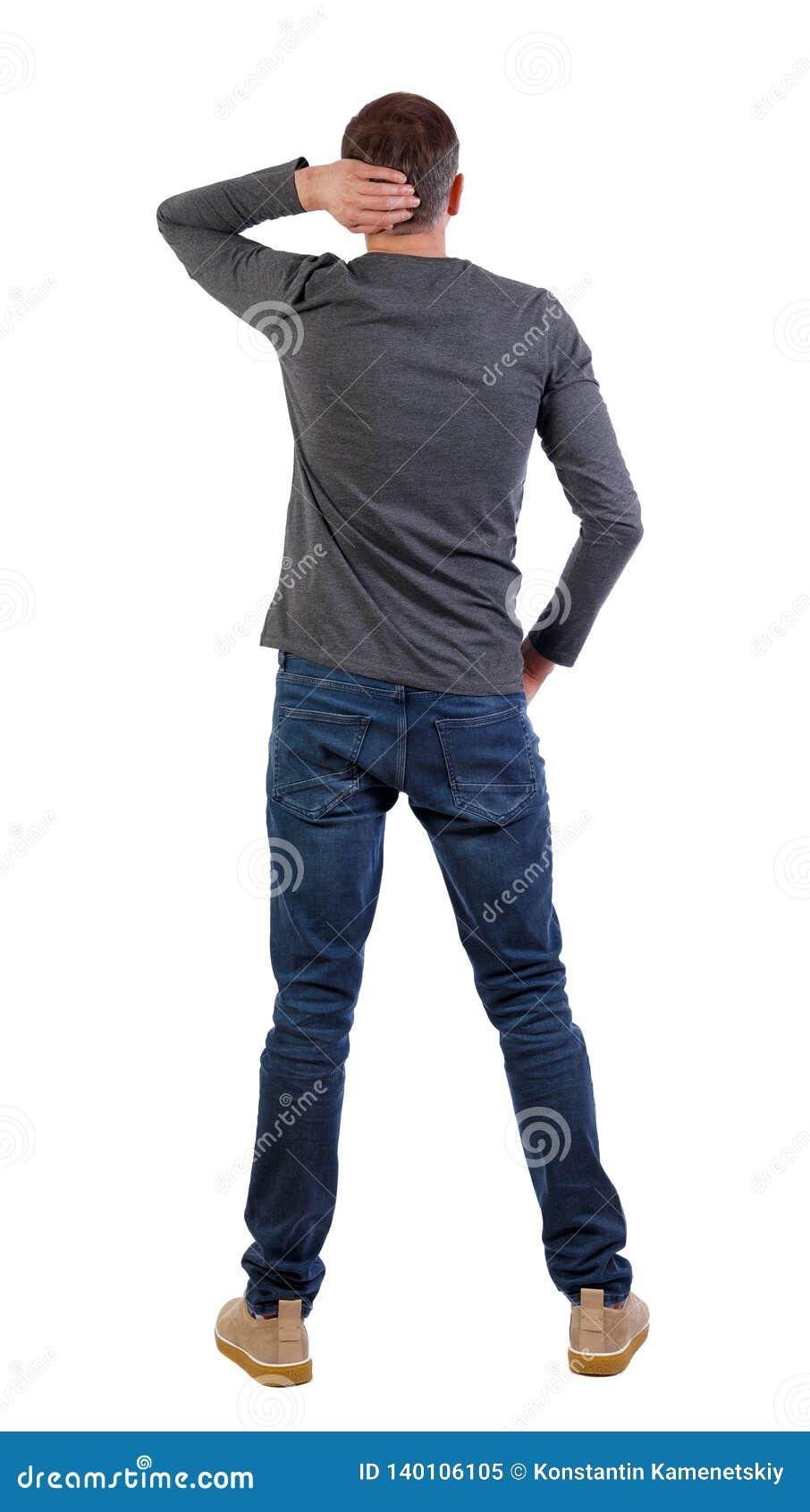 后面观点的牛仔裤的人 常设年轻人