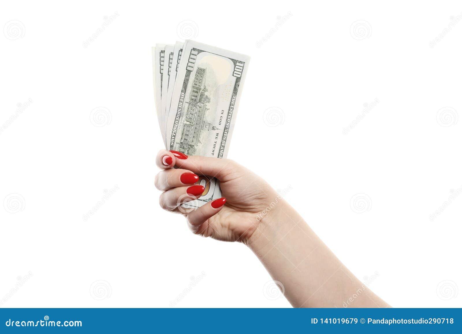 女孩在白色背景拿着很多一百元钞票被隔绝