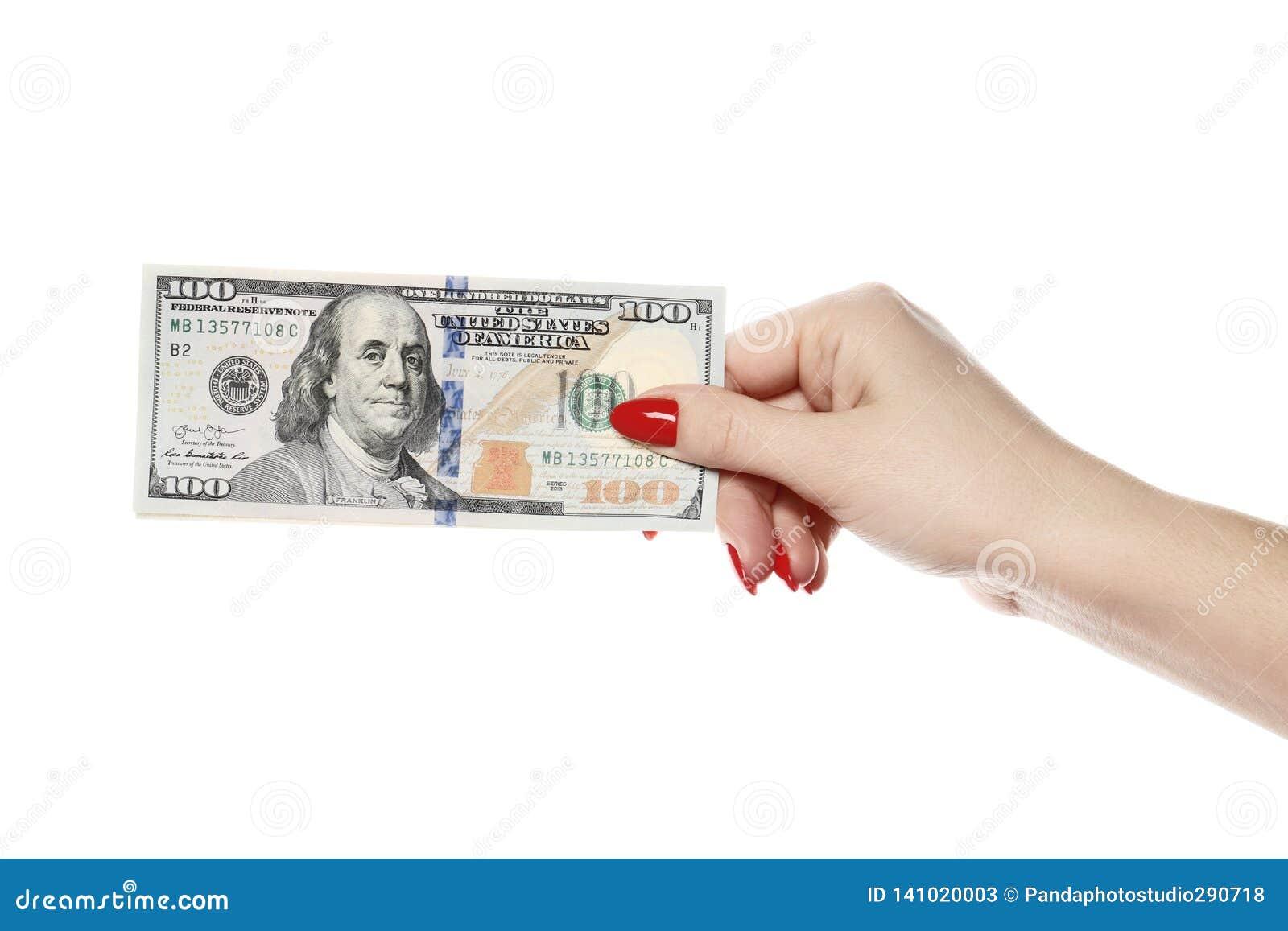 完善的妇女递举行在白色背景隔绝的一百美元
