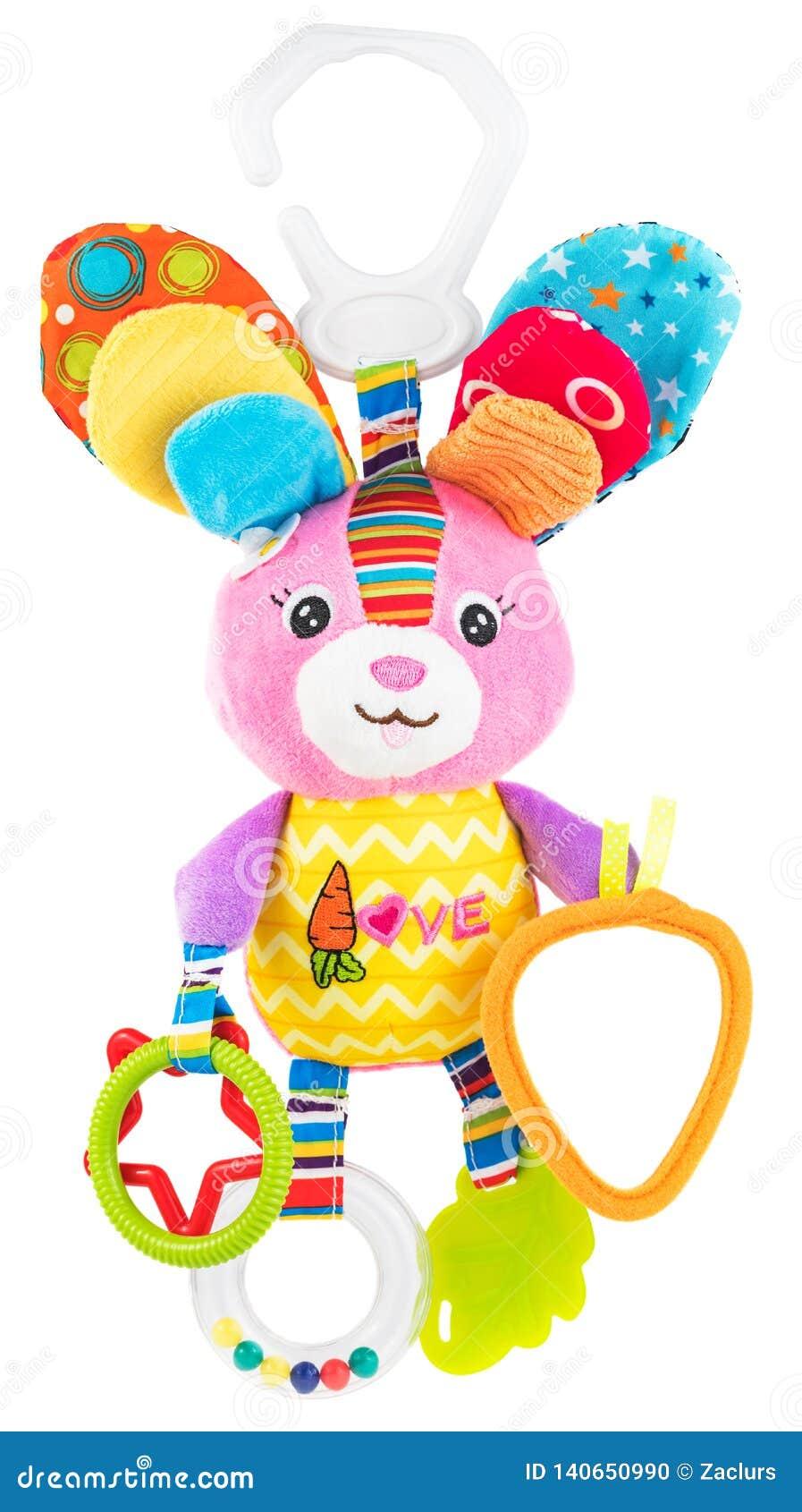 在白色隔绝的婴孩耐嚼的玩具兔子