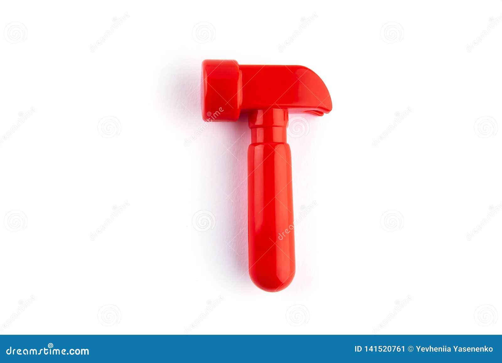 在白色隔绝的玩具红色锤子 texs的地方