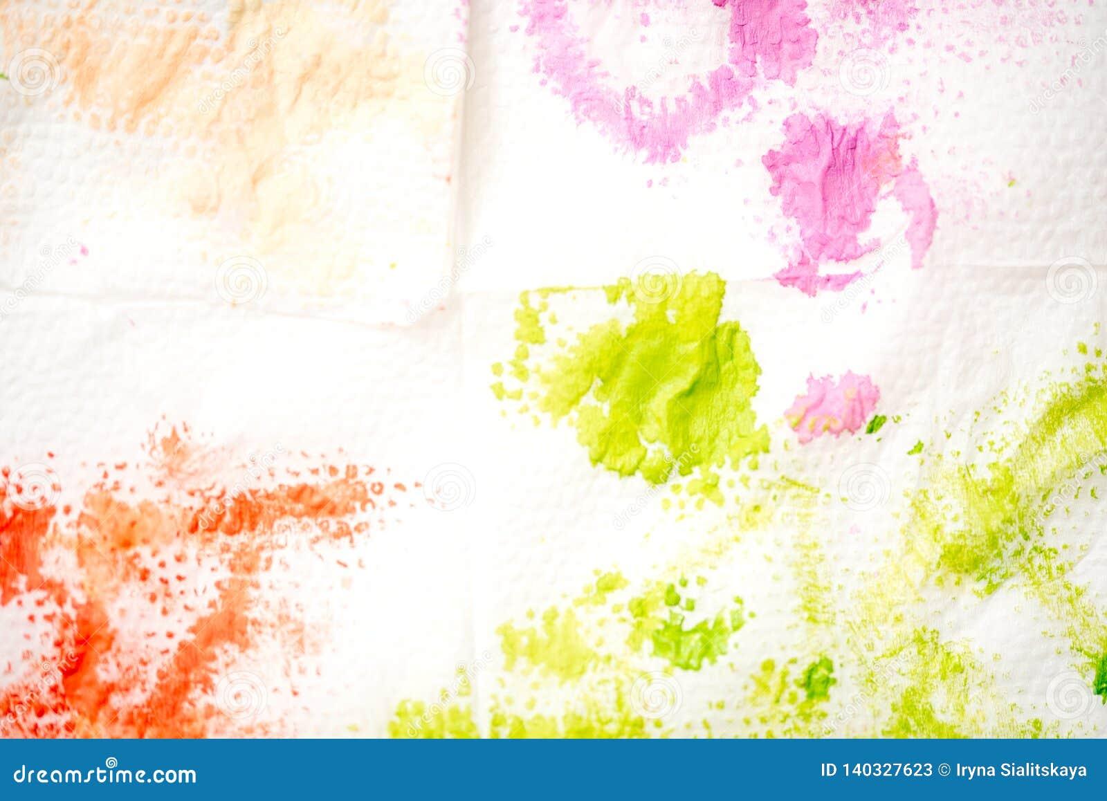 抽象背景手画水彩 油漆绿色污点在一块白色餐巾的