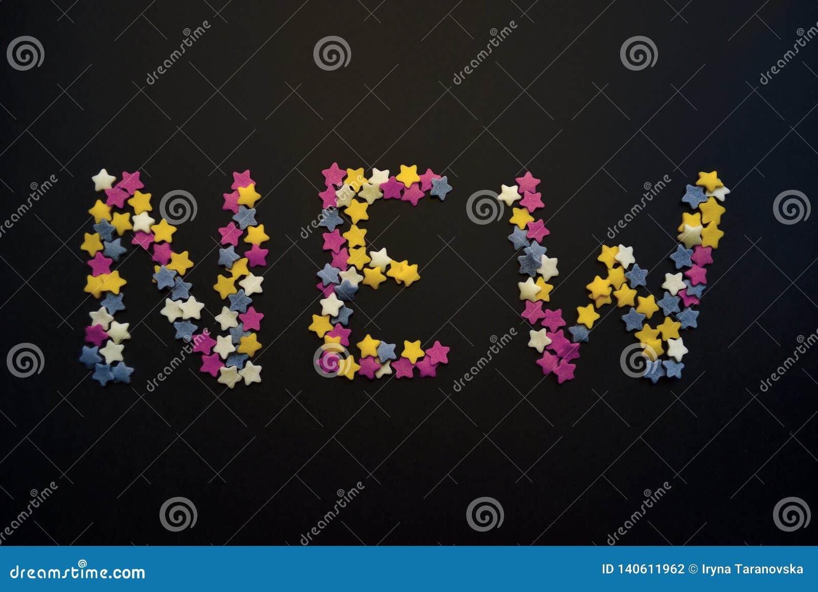 新的词在糖酥皮点心星的重类型被写在黑背景,为,广告,商务,销售