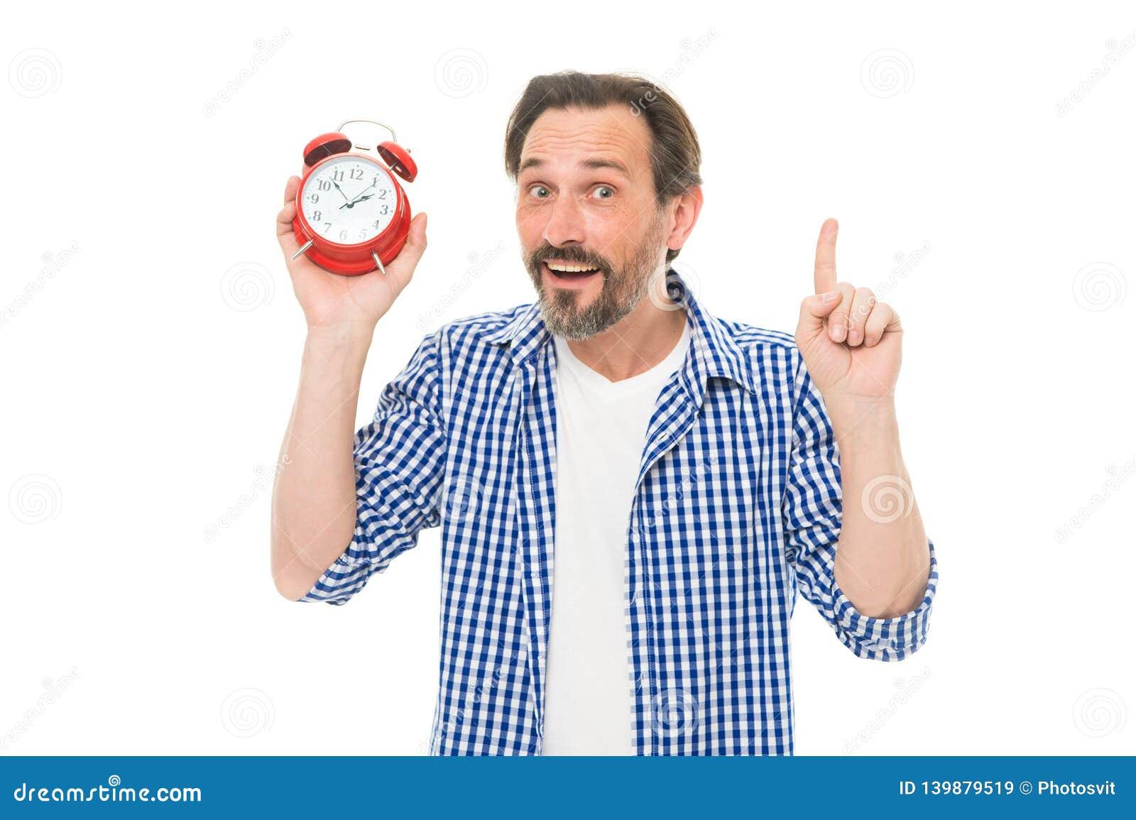 记录时间 有模式时钟的成熟计时员指向手指的  成熟人藏品闹钟 博若莱红葡萄酒